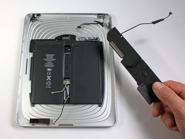 Image 2/2: Remove the speaker assembly from the rear panel assembly.