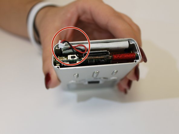 To replace the battery, simply insert a new one into the same slot and then plug in the end to the correct spot.