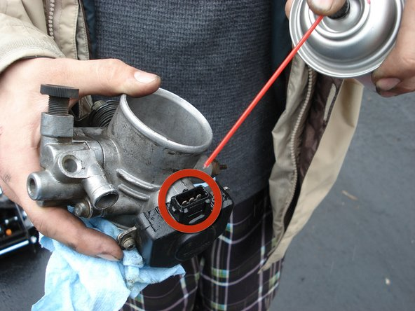 Image 1/2: Spray off the wiring clip that attaches to the throttle body inside the engine bay.