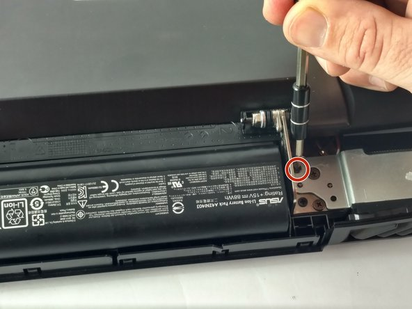 Remove the four 6.8 mm screws holding the monitor in place, using a Phillips screwdriver.