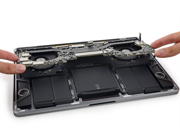 Image 1/2: The symmetrical logic board keeps guard over the remaining components, so we spudger off its connecting cables and wrest it free from the case.