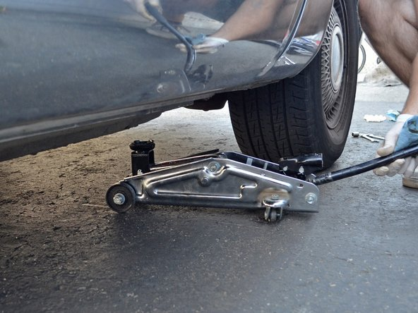 Slowly remove the jack stand and lower the car to the ground.