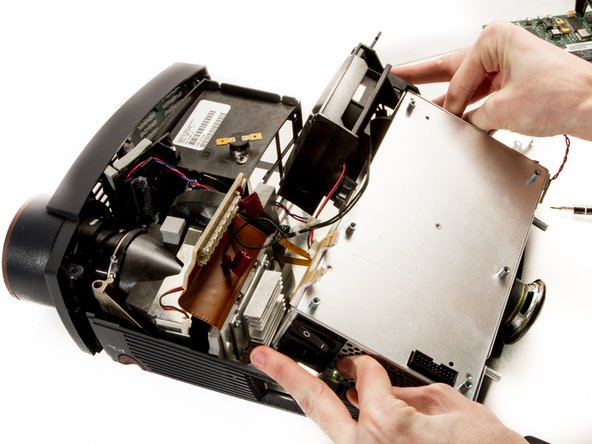Use your thumbs to pry the sides of the external shell away from the power supply so it can be lifted out.