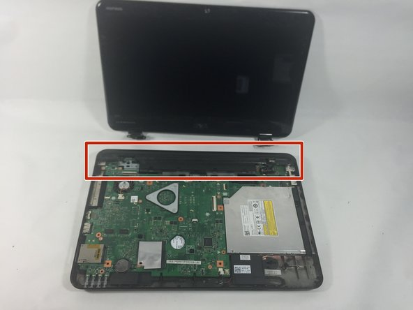 Image 2/3: Pull up and away on the black hinge cover with moderate force to release from the device.