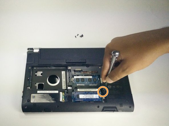 Remove the final screw in the center to release the motherboard from the case.