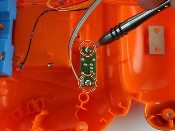 Using a Phillips PH1 screwdriver, remove the two 7.9 mm volume switch board screws.