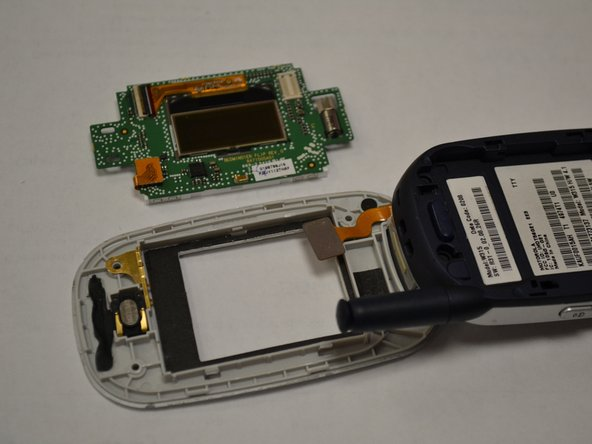 Image 2/2: Remove display circuit board from the body of the phone.
