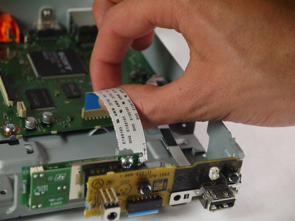 When handling circuit boards like the motherboard and port board, make sure to only touch them on the sides.