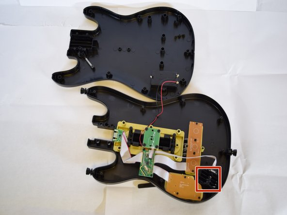 Image 1/1: To remove the whammy bar, follow the steps included in the whammy bar replacement guide, found on our device.