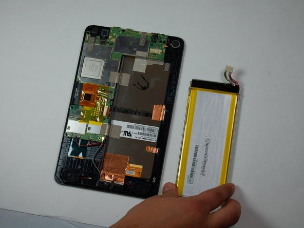 Move around edges of the battery to lift it off of the tablet.