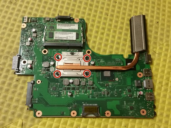 Remove the four screws securing the heatsink to the motherboard.