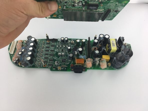 Lift control board up and away from power supply board.