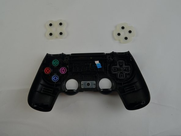Do not turn the front shell cover upside down after completing this step, because some of the buttons may fall out.