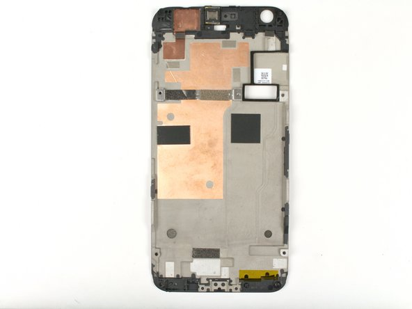 Once you have removed the mid-frame from the device, flip the frame over so that the copper tape is visible.