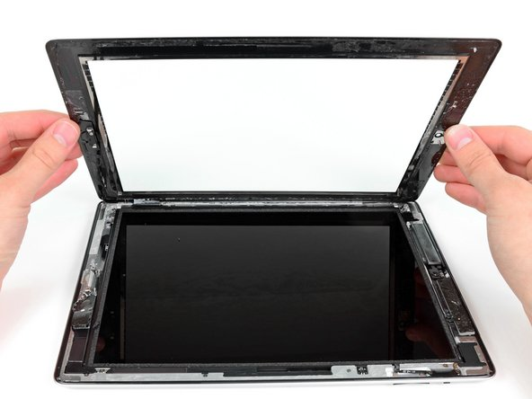 Carefully rotate the front panel away from the iPad, being sure that no adhesive is still attaching the two components.