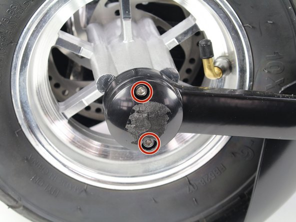 Remove the two, 16 mm Hex #4 screws on both of the hub caps in the front wheel.