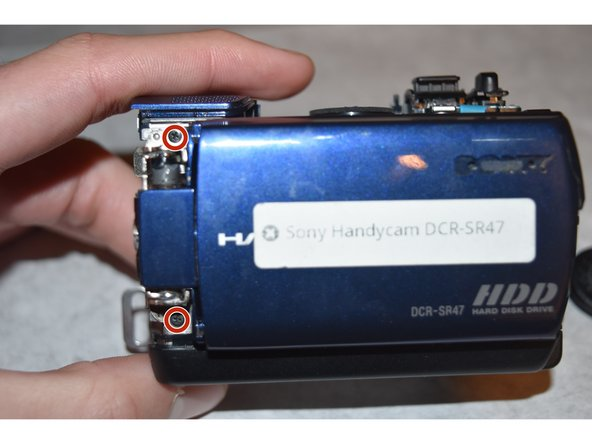 Image 2/3: Carefully detach the LCD Screen from the rest of the camera.