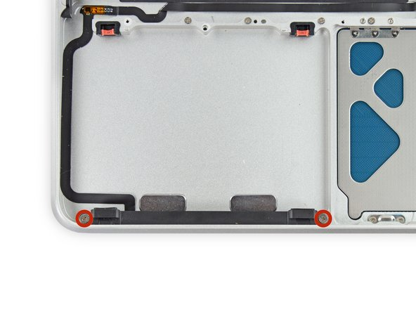 Remove the two 5 mm Phillips #00 screws securing the hard drive bracket to the upper case.
