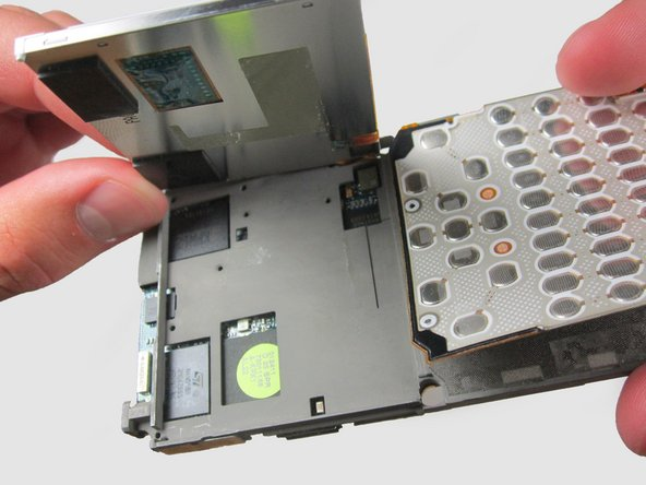 To remove the casing as a whole, slowly lift up and towards the right side of the phone.