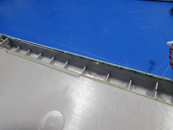 Image 3/3: With the keyboard apart, it is evident that Microsoft used double sided tape around each key and glue on the exterior keyboard edge.