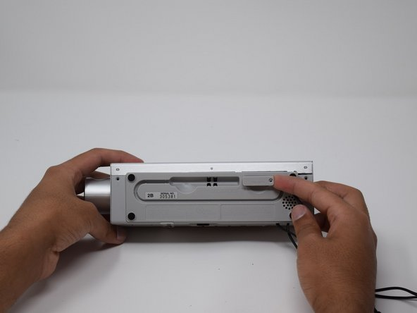 Once you have removed the screw from the battery cover, pull out the cover using your fingers.