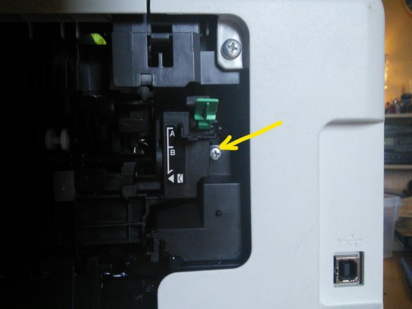 With the white flap off, unscrew the single screw and pry out this black cover.
