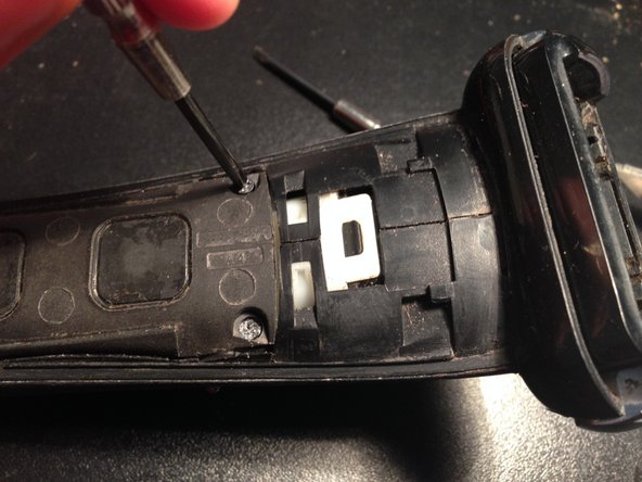 Remove the 4 philips screws and pull off the plastic cover