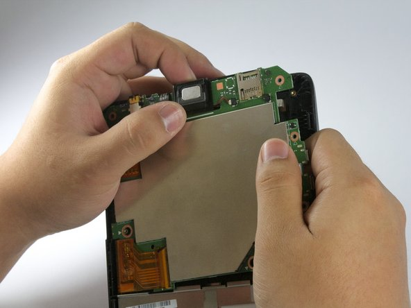 Image 1/2: With your fingers, slowly pull out the wire connecting the speaker to the motherboard.