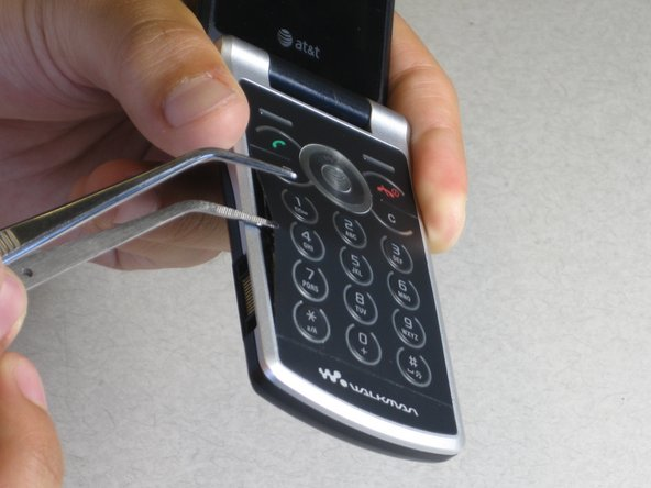 Use the tweezer to pry under the keypad.
