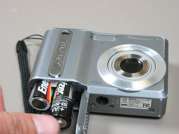 Image 2/2: Keep the battery flap open.
