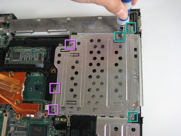 Remove three screws near the edge of the computer, holding the optical bay and HDD covers.