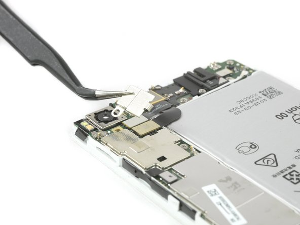 Remove the metal clamp covering the flex connector of the front camera.
