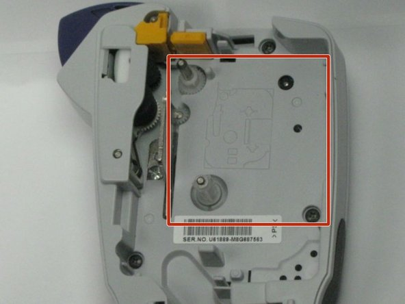 Image 1/1: Insert tape cassette into the red marked area as shown in the picture.