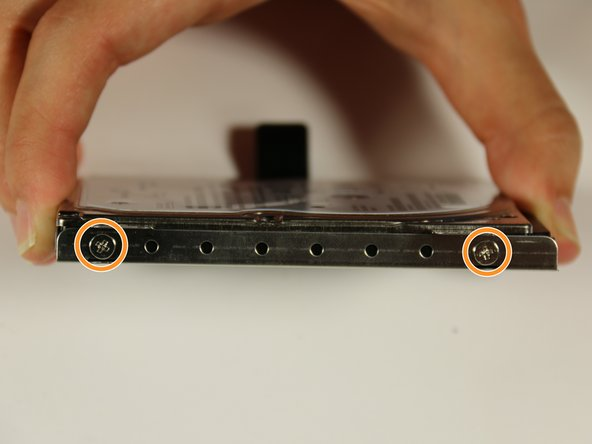 Image 2/3: There should be 4 total screws, 2 on each side.