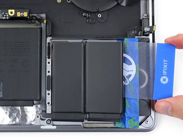 Repeat the previous two steps to separate the remaining battery cell on the right.