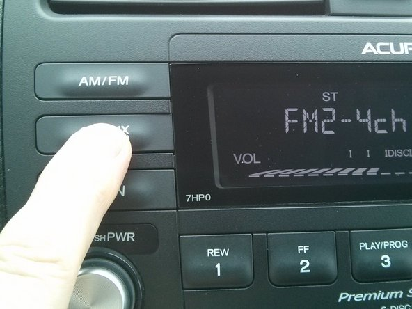 :Press and hold the CD/AUX button on the base model stereo head unit for 10 seconds.