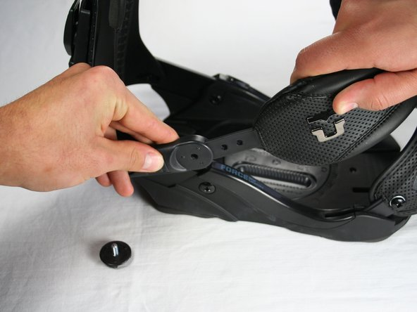 Pull the heel strap apart from its binding connector.