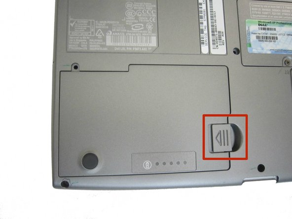 Locate the laptop battery release button lock