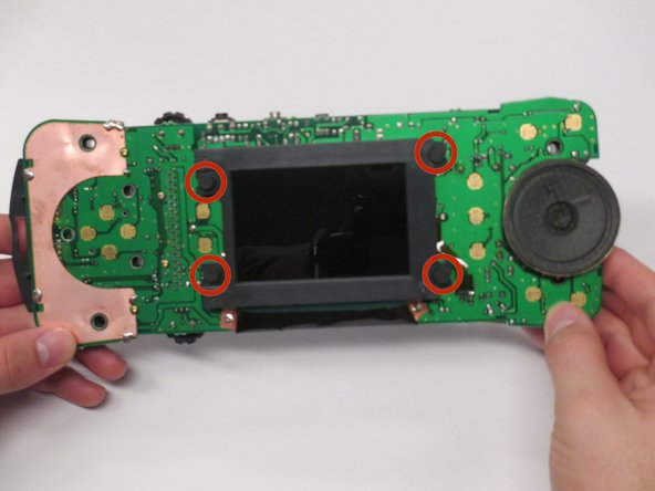 Image 1/1: Pull to the sides the four rubber tabs holding in the screen