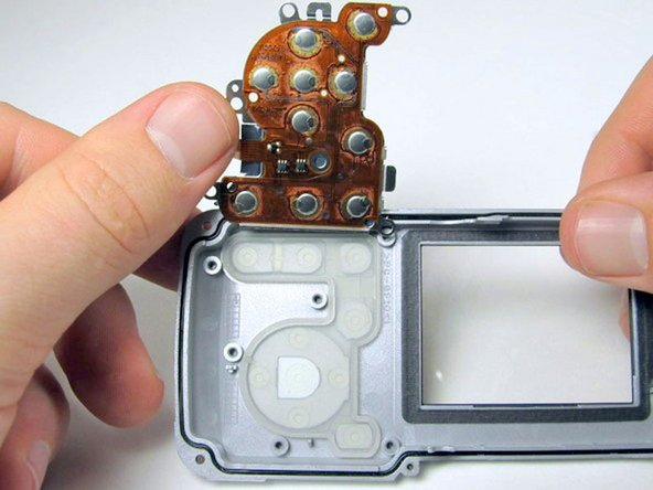Flip the metal casing up to reveal the back buttons.