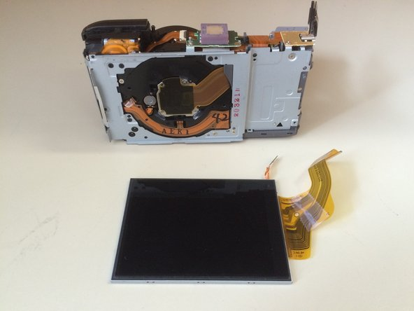 Gently slide the LCD screen to the right and remove.