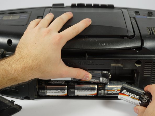 The top row of batteries have the positive side pointing right. The bottom row of batteries have the positive side pointing left.
