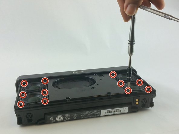 Remove four screws from each of the four speakers (16 screws total) using a Torx #10 screwdriver.