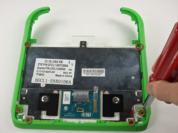 Image 1/3: Remove all of the green plastic parts from the laptop.