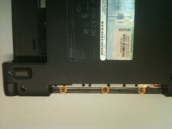 Remove 3 small (2.5x3mm) screws from the optical drive bay area.