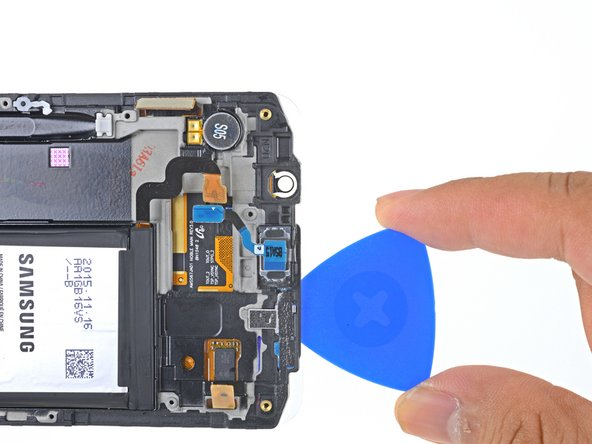 Cut along the top edge of the phone, making sure not to insert the pick more than 0.25 inches (~6 mm) to avoid damaging the front-facing sensors.