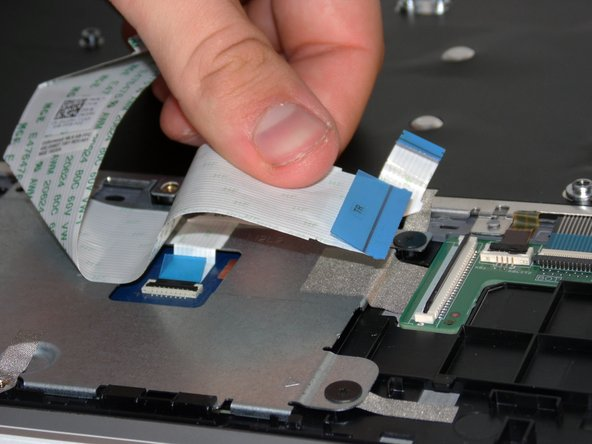 You can further disassemble by removing the touchpad.