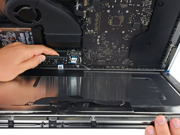 After confirming that your iMac functions properly, disconnect the display cables and carefully lean the display forward.
