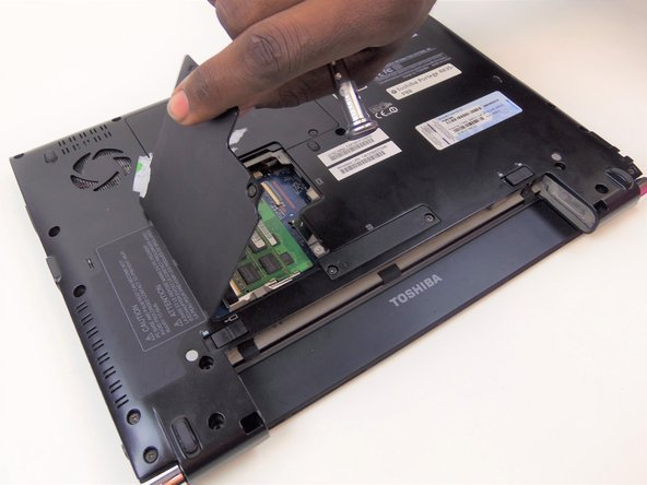 Remove the remaining screws from the bottom cover using phillips head screwdriver #PH00.