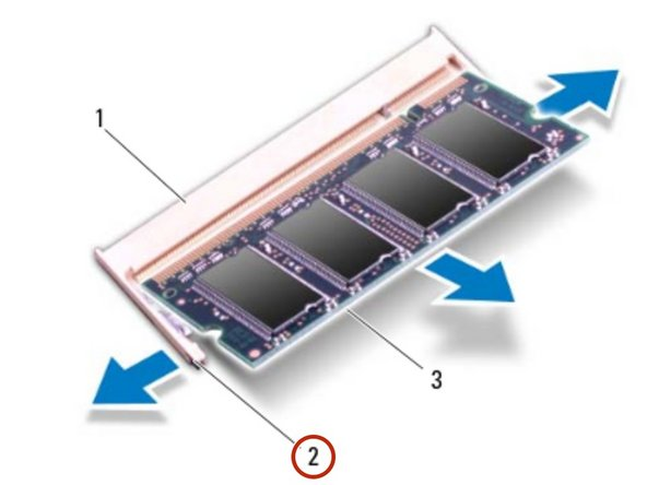 Use your fingertips to carefully spread  apart the securing clips on each end  of the memory-module connector un til the memory module pops up.